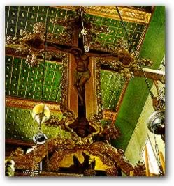Suspended above the gilded iconostasis in the central aisle