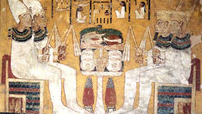 Here, the Four Sons of Horus hold flails only, in both hands, above the canopic chamber door in the tomb of Aye