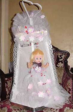 The doll is used as a symbol to announce that the new baby is a girl. For a boy, they use a doll on a horse