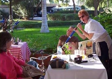 Kathy tries out Tigger's  Pipe at the Movenpick on Crocodile Island