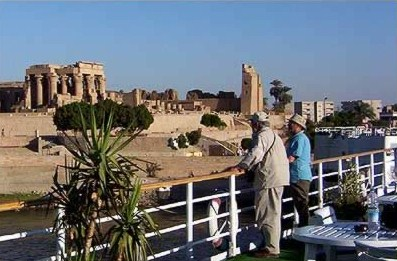 Billy oates and brother examine Kom Ombo from the deck of the Radamis I