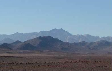 A view of Mount Sinai from a  distance. It is the highest peak in the background