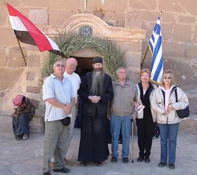 In front of the entrance to St. Catherine's Monastery, from left to right, Darrell Young, Jimmy Dunn, Father Justin, James Oates, Kathy Oates and Rita Young