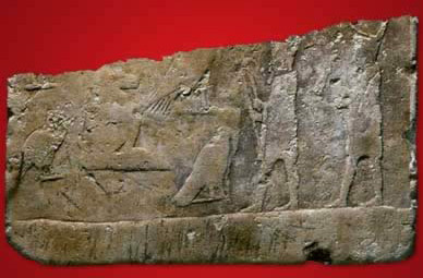 A limestone slab decorated with a scene consisting of two standing kings found in Tomb No. 3507