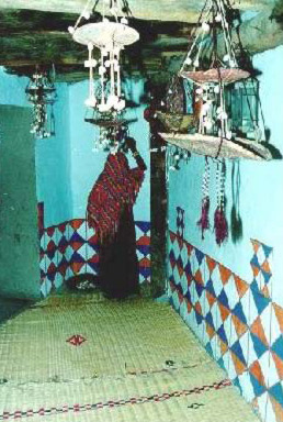 The interior of a Nubian house with colourful decorations and mats
