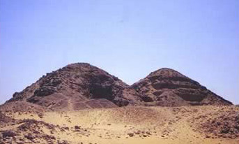 In the foreground, the Pyramid of Neferirkare at Abusir in Egypt