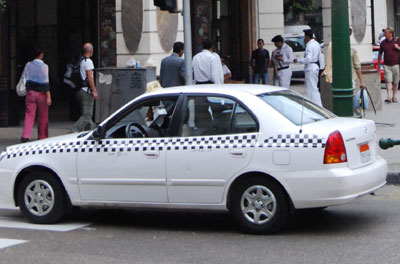 Picture of a White taxi with black checkers