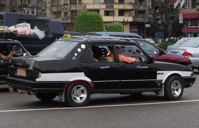 Picture of a Black and White Taxi in Cairo streets, Egypt