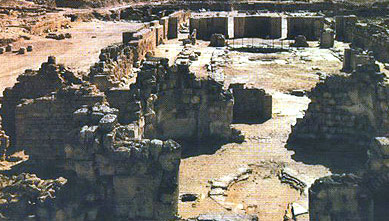 An older color photo of the ruins of the main churches at Abu Mina