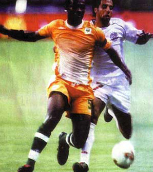 Hassan Mostafa from Egypt with a player from Ivory Coast