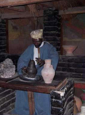 Display of an Egyptian making pottery