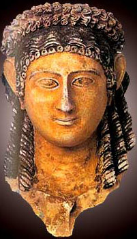 A Roman era funerary mask of a woman on display in the Museum
