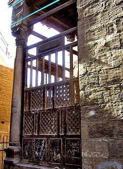 Exterior view of the kuttab's wooden Mashrabeyya screen
