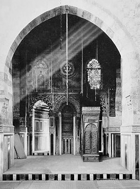 An old photo of the Qibla iwan also showing the minbar