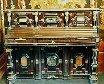 A piano inlaid with stones