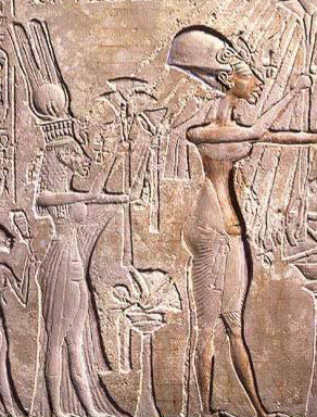 A well known relief of the royal family in the early Amarna style, displaying lsome traces of the grid pattern used.