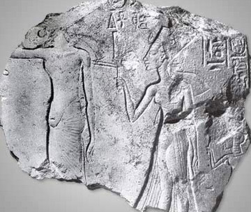 Fragment of limestone showing Akhenaten (left) and Nefertiti (right), clearly with different treatments of the genital region