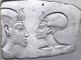 Bust engravings of Akhenaten and Nefertiti in a somewhat less exaggerated form