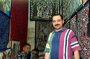 Mohamed Kamel Youssef, an Applique shop owner