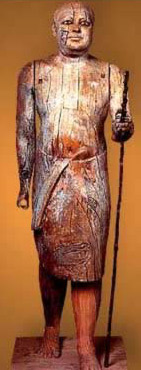 Sycamore wood statue of a Bearer from the 5th Dynasty