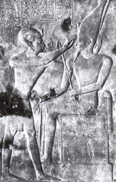 Seti I placing the double crown of Upper and Loeer Egypt on the head of Atum