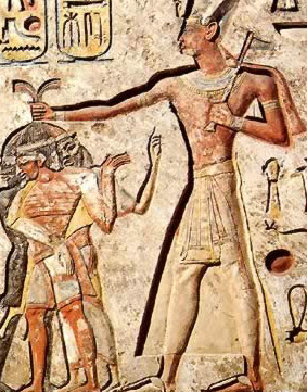 Ramesses II smiting his enemies with a battle axe rather than a mace