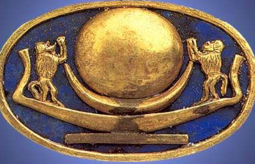 A ring with a solar barque together with too baboons from the tomb of Tutunkhamun