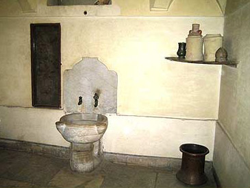 The hot water room of the bath section of the house