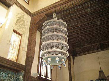 A view of one of the lanterns and the Persian Style celing