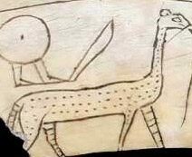 An early magic wand with a fairly crude depiction of a serpopard