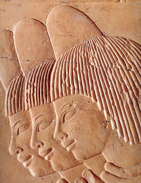 More often than not, common women are depicted wearing perfume cones on their heads, which slowly released perfumed fats into their hair, as in this relief from the tomb of Khaemhat on the West Bank at Luxor