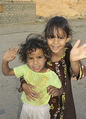 Happy Bedouin children, dessed in more modern clothing