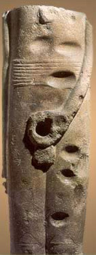 Fragment of a statue  of Min from the late Predynastic Period, discovered at Coptos