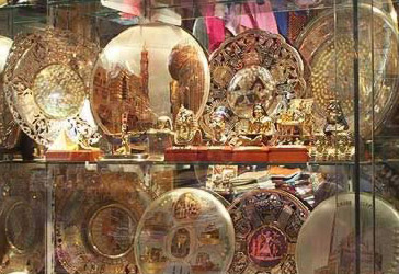 A wide variety of brass plates in an Egyptian shop window