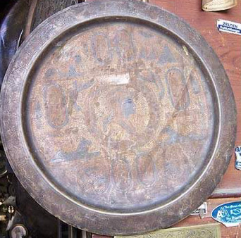 Faded colors of an oxidized brass plate