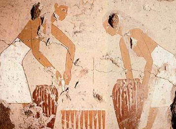 Women filling bread   moulds with dough from large jars and stanking them from for baking from   a painting in the tomb of Senet on the West Bank at thebes (12th   Dynasty)