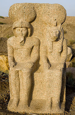A worn but fine granite statue of Pharaoh and Sekhmet at Buto