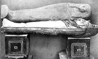 ancient egyptian coffin in a tomb