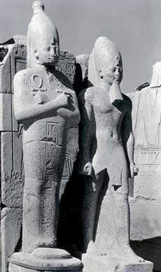 Colossus statues on the North face of the Seventh Pylon in the Courtyard of the Cachette in the Temple of Amun at Karnak