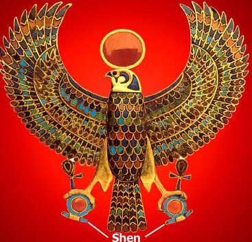 A Horus Falcon from the tumb of Tutankhamun, his head surmounted by a solar disk, his talons holding shen