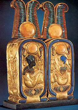 In this double cartouche box, each part surmounted by the two feathers crown, is depicted King Tutankhamun himself, rather than his name