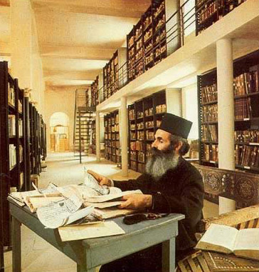 A monk in the Library of St. Catherine's Monastery
