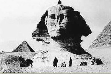 An early photo pror to the Great Sphinx at Giza, Egypt being uncovered from the sand