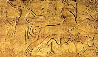 Ramesses III in his chariot from the walls at Medinet Habu