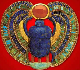A very colorful winged scarab with a sun disk, made of gold, carnelian, turquoise, greed feldspar, lapis lazuli and calcite, from the tomb of King Tutankhamun