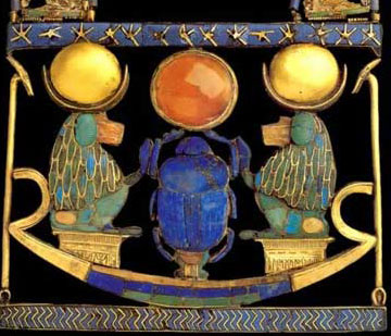 This pectoral, from the tomb of Tutankhamun, employs gold, silver, semiprecious stones and glass paste. Note the similarity in the colors to the winged scarab above. The baboons have a solar aspect.