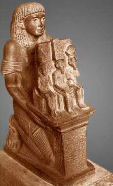 Statue of worshipper presenting votive of Mut, Amun and Khonus