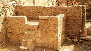 A worker's house at Deir el-Medina showing a feature that may have served both as a bed and a domestic altar