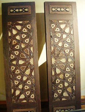 A door, dating to the Mamluk period, with typical geometric designs and inlaid with bone