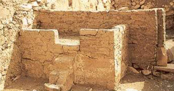 Workers house at Deir el-Medina showing what probably served as both a bed and a domestic altar